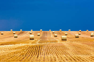 Prairie Storm Photograph - Bales On The Storm by Todd Klassy