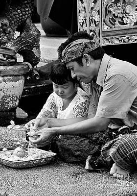 Photograph - Balinese Father And Daughter Making Offerings by Craig Lovell