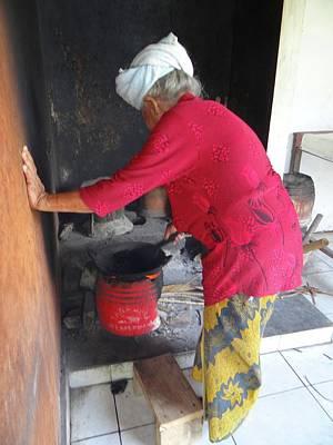 Exploramum Photograph - Balinese Lady Roasting Coffee Leans Again Wall by Exploramum Exploramum