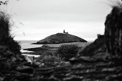 Photograph - Ballycotton Ireland Lighthouse Through Village Stone Wall County Cork Black And White by Shawn O'Brien