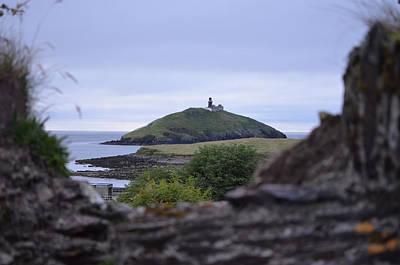 Photograph - Ballycotton Ireland Lighthouse Through Village Stone Wall County Cork by Shawn O'Brien