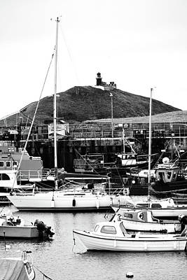 Photograph - Ballycotton Ireland Marina Harbor Boats And Lighthouse County Cork Black And White by Shawn O'Brien