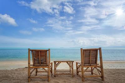 Bamboo Chair Photograph - Bamboo Wood Chair On The Beach  by Anek Suwannaphoom