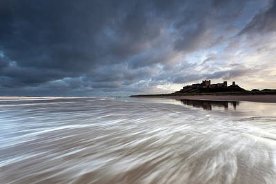 Northumberland Photograph - Bamburgh Castle At High Tide In The Surf by Anita Nicholson