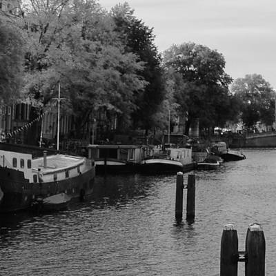 Photograph - barges on river Amstel by Cheryl Miller