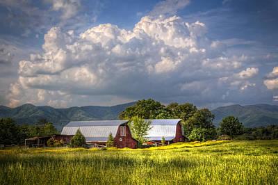 Barns Under The Clouds Art Print by Debra and Dave Vanderlaan