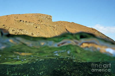 Bartolome Island Rock And Water Surface Print by Sami Sarkis