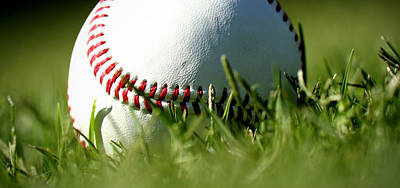 Sports Photograph - Baseball In Grass by Chris Brannen