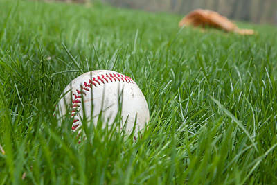 Baseball Closeup Photograph - Baseball In Grass With Glove Behind by Erin Cadigan