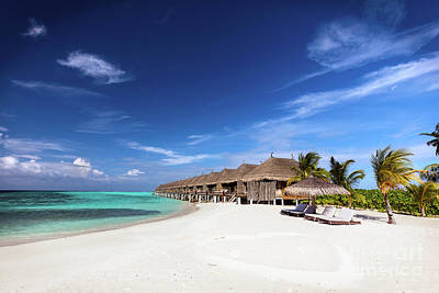 Ocean Photograph - Beach And Water Villas On A Small Island Resort In Maldives, Indian Ocean. by Michal Bednarek