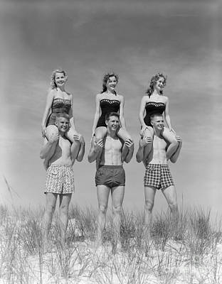 Photograph - Beach Balancing Act, 1950s-60s by H Armstrong Roberts and ClassicStock