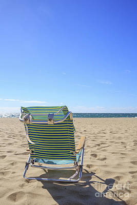 Cape Cod Photograph - Beach Chair On A Sandy Beach by Edward Fielding