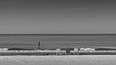 Photograph - Beach Chairs And Paddler by Steve Gravano