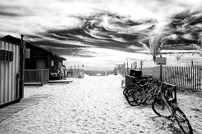 Photograph - Beach Entry Bikes by John Rizzuto