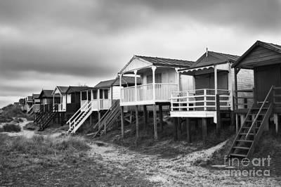 Beach Huts North Norfolk Uk Art Print by John Edwards
