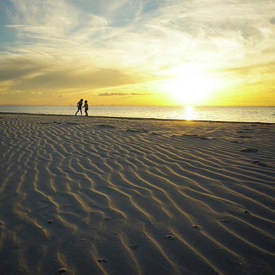 Beach Silhouettes And Sand Ripples At Sunset Art Print