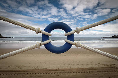 Buoys Photograph - Beach Through Lifeguard Tied With Ropes by Carlos Ramos