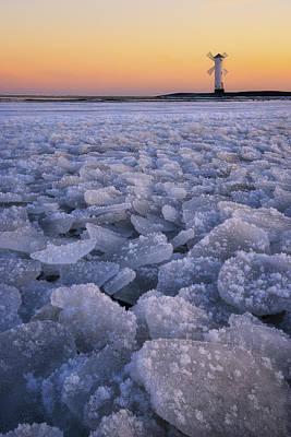Photograph - Beautiful Sunrise Over A Windmill-shaped Lighthouse. Swinoujscie, Poland. by Marek Kijevsky
