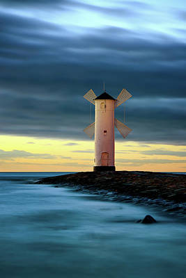 Photograph - Beautiful Sunset Over A Windmill-shaped Lighthouse. Swinoujscie, Poland. by Marek Kijevsky