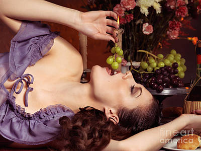 Beautiful Woman Eating Grapes On A Festive Table Art Print