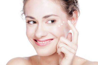 Photograph - Beautiful Young Woman Smiling And Putting Eye Cream. by Michal Bednarek
