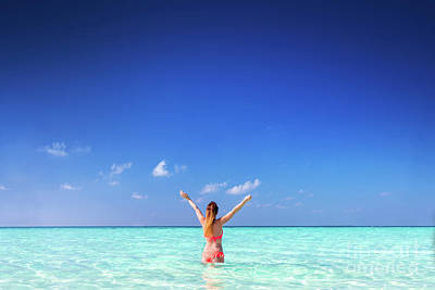 Photograph - Beautiful Young Woman Standing In The Ocean With Hands Raised. Maldives by Michal Bednarek