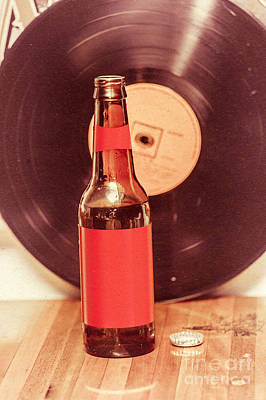Beer Royalty-Free and Rights-Managed Images - Beer bottle on bar counter top with vinyl record by Jorgo Photography - Wall Art Gallery