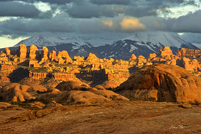 Behind The Rocks Photograph - Behind The Rocks And La Sal Mountains by Dan Norris