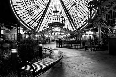 Dramatic Photograph - Bench And Wheel At Night In Black And White by Greg Mimbs