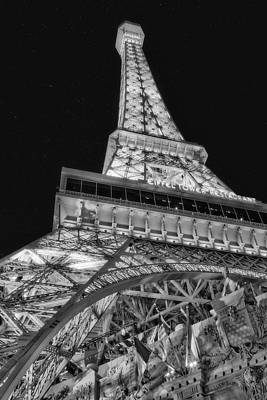 Beneath The Eiffel Tower Art Print by Susan Candelario