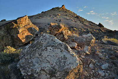 Photograph - Bentonite Hills And Boulders Light At Sunrise by Ray Mathis