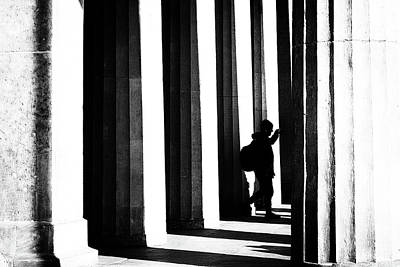 Street Photograph - Between Pillars by Frank Andree