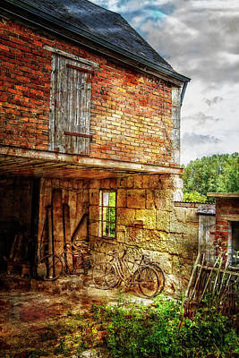 Velo Photograph - Bicycles In The Courtyard by Debra and Dave Vanderlaan