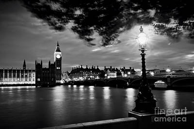 Photograph - Big Ben, London The Uk At Sunset. Retro Street Lamp Light On Westminster Bridge. Black And White by Michal Bednarek