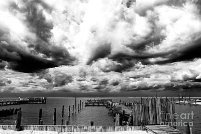 Big Clouds Little Dock Art Print by John Rizzuto