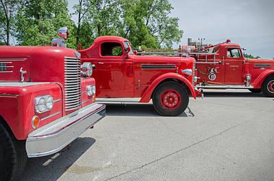 Photograph - Big Red Trucks by Susan McMenamin