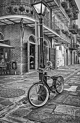 Photograph - Bike And Lamppost In Pirate's Alley- Bw by Kathleen K Parker