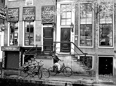 Photograph - Bike Riding In The Red Light District by John Rizzuto