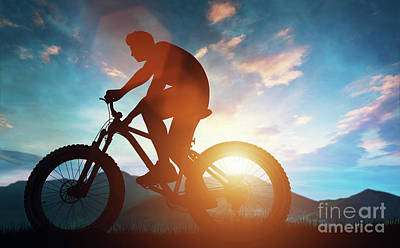 Photograph - Biker Riding His Bicycle In The Mountains. by Michal Bednarek