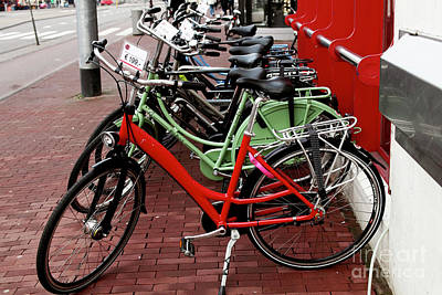 Photograph - Bikes For Sale by John Rizzuto