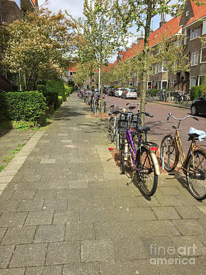 Photograph - Bikes In A Street In Holland by Patricia Hofmeester