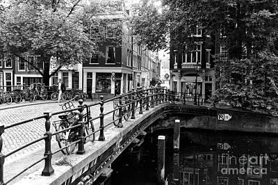 Photograph - Bikes On The Canal Bridge Mono by John Rizzuto