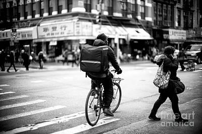 Photograph - Biking In The City by John Rizzuto