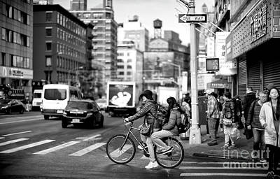 Photograph - Biking On Canal Street by John Rizzuto