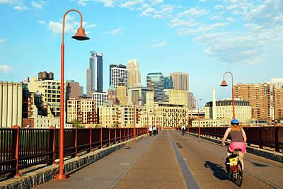 Photograph - Biking On The Stone Arch Bridge by James Kirkikis