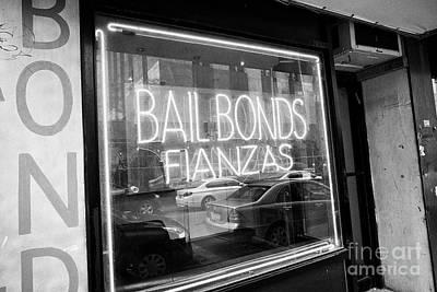 Window Signs Photograph - bilingual english spanish neon bailbonds fianzas sign near courthouse in New York City USA by Joe Fox