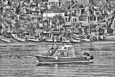 Photograph - Black And White Boat by Jim Walls PhotoArtist