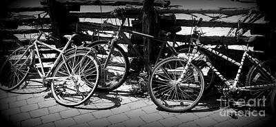 Black And White Leaning Bikes Art Print by Emily Kelley