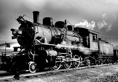 Birds Rights Managed Images - Black and white of an old steam engine  Royalty-Free Image by Jeff Swan