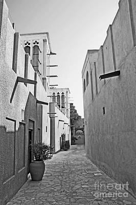 Black And Whitetraditional Middle Eastern Street In Dubai Art Print by Chris Smith